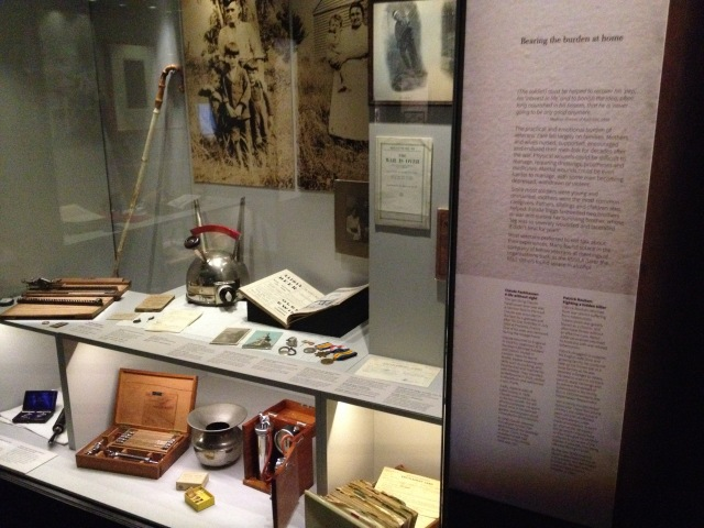 Love and Sorrow exhibition case showing density of objects and text, Melbourne Museum, 2015