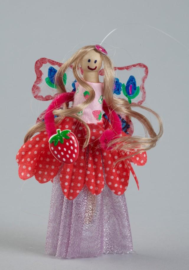 Magic Strawberry Fields peg doll, 2011, made by Ella Hermens. Gift of Ella Hermens, 2011. © Te Papa. CC BY-NC-ND licence. Te Papa (GH017395)
